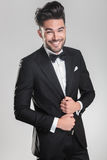 Young man wearing a tuxedo smiling Stock Image