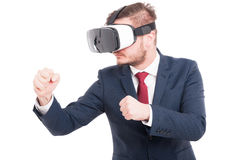 Young man wearing virtual reality goggles Royalty Free Stock Photography