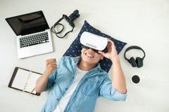 Young man wearing virtual reality goggles. Top view of Man wearing virtual reality goggles stock photo