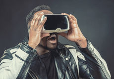Young man wearing virtual reality googles / VR Glasses Stock Photo