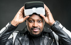 Young man wearing virtual reality googles / VR Glasses Stock Photography