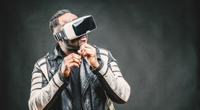 Young man wearing virtual reality googles / VR Glasses Royalty Free Stock Photo