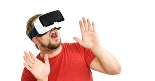 Young man wearing virtual reality googles / VR Glasses Stock Image