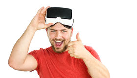 Young man wearing virtual reality googles / VR Glasses Royalty Free Stock Images