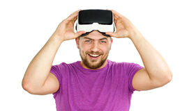 Young man wearing virtual reality googles / VR Glasses Royalty Free Stock Image