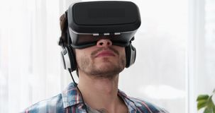 Young man wearing virtual reality device stock video