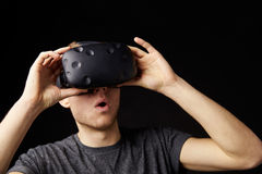 Young Man Wearing Virtual Reality Headset In Studio Royalty Free Stock Images