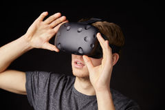 Young Man Wearing Virtual Reality Headset In Studio Stock Image