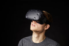 Young Man Wearing Virtual Reality Headset In Studio Royalty Free Stock Photo