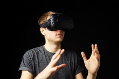 Young Man Wearing Virtual Reality Headset In Studio Stock Photo