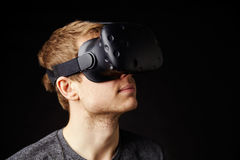 Young Man Wearing Virtual Reality Headset In Studio Stock Images