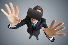 Young man is wearing virtual reality headset. View from top.  Stock Image