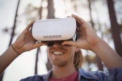 Young man wearing virtual reality simulator Stock Photography