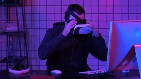 Young Man Wearing VR Headset And Experiencing Virtual Reality stock image