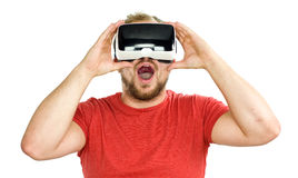 Young man wearing VR virtual reality goggles Royalty Free Stock Images