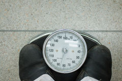 Young man wearing a weighing. Scales With analog measurement Stock Photos