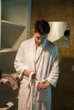 Young man wearing white bathrobe in spa Stock Photo