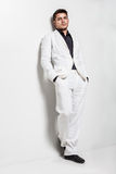 Young man wearing white suit Royalty Free Stock Photos