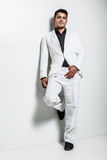 Young man wearing white suit Royalty Free Stock Photography