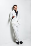 Young man wearing white suit Stock Photo