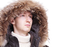 Young man wearing winter jacket Stock Photos