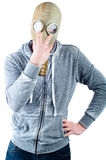 Young man wears a gas mask Royalty Free Stock Photos