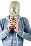 Young man wears a gas mask Royalty Free Stock Photo