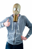 Young man wears a gas mask Royalty Free Stock Images