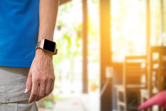 Young man wears smart watch in coffee shop. With morning light Stock Photography