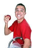 Young man with weigh. And red apple Stock Photos