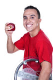 Young man with weigh. And red apple Stock Image