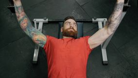 Young man weightlifter training with barbells at gym. CrossFit athlete portrait. stock video footage