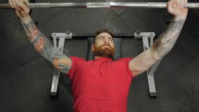 Young man weightlifter training with barbells at gym. CrossFit athlete portrait. stock video
