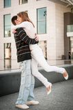Young man welcomes his girlfriend Royalty Free Stock Photography