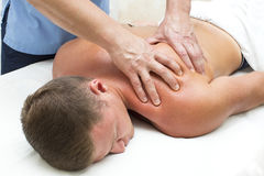 Young man on wellness treatments. Young men on wellness treatments sports massage Royalty Free Stock Image