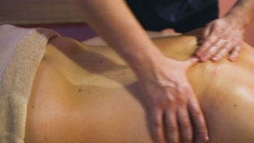 Young man on wellness treatments sports massage closeup stock video footage