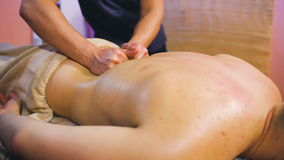 Young man on wellness treatments sports massage closeup stock video