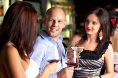 Young man and wemen at the bar Royalty Free Stock Photography