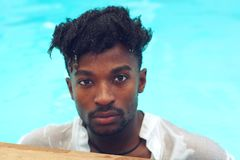 Young man wet shirt pool water swimming vacation royalty free stock photo