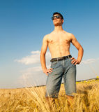 Young man on wheat field Stock Photo