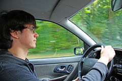 The young man at the wheel cars Stock Images
