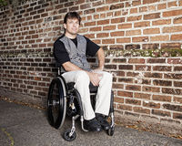 Young man in wheelchair. Young to middle age man in wheelchair with determined expression royalty free stock photography