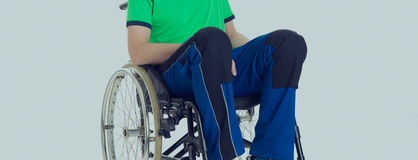 Young man in a wheelchair Royalty Free Stock Image