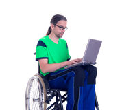 Young man in a wheelchair with laptop Stock Images