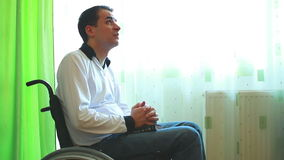 Young man in wheelchair praying Stock Photography