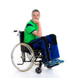 Young man in a wheelchair is sad Royalty Free Stock Images
