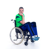 Young man in a wheelchair is sad Royalty Free Stock Image