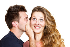 Young man whispering a secret Stock Image