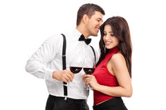 Young man whispering something to a woman. Young men whispering something to a women isolated on white background Stock Photos