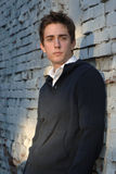 Young man on white brick wall Royalty Free Stock Photography